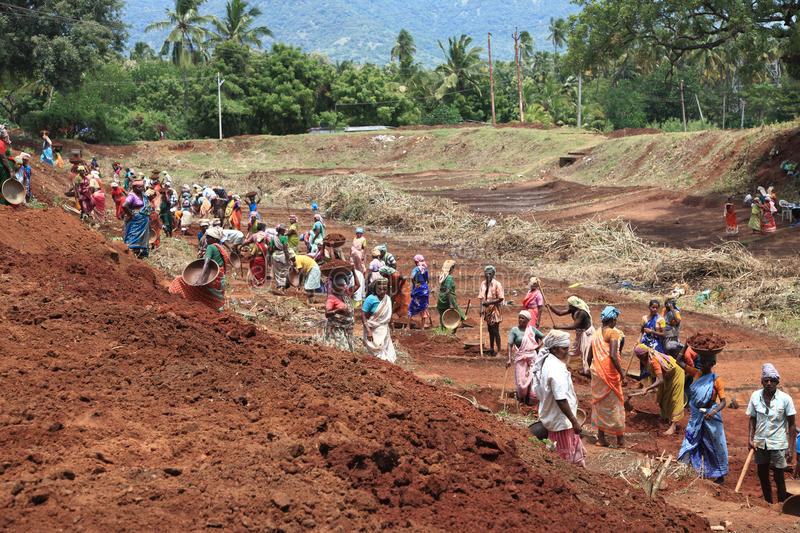People working on a public land. People are working on a public land under NREGA on September 25 , 2010 in Nagarcoil, Tamilnadu. NREGA is Mahathma Gandhi stock photos