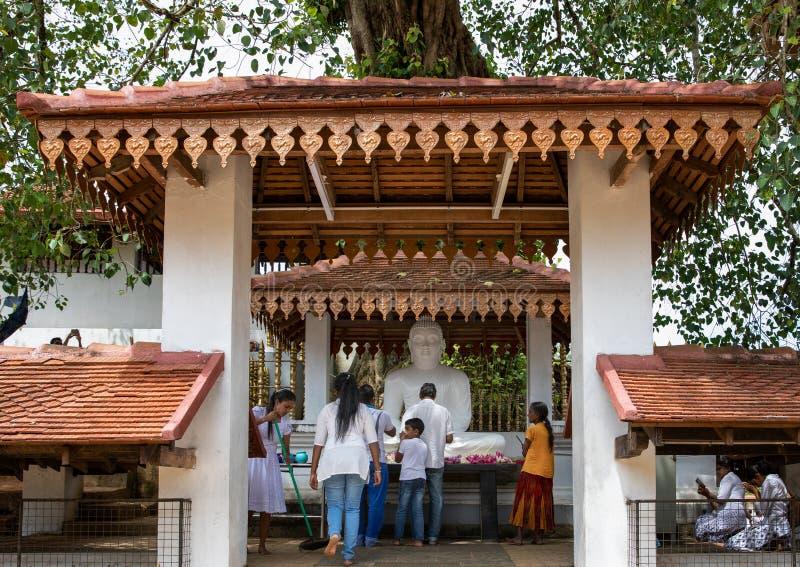 People worship Buddha at Maha Saman Devalaya or the Great Saman Temple. A shrine dedicated to Deity Saman in Ratnapura, Sri Lanka royalty free stock photography