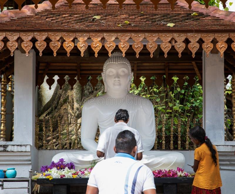People worship Buddha at Maha Saman Devalaya or the Great Saman Temple. A shrine dedicated to Deity Saman in Ratnapura, Sri Lanka royalty free stock photos