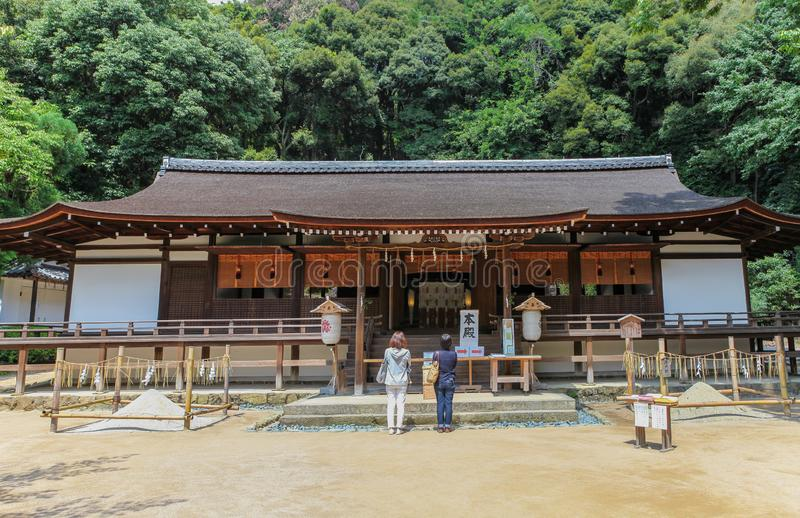People worship at the Honden main hall of the Ujigami Shrine. In Uji, Japan. A National Treasure of Japan and UNESCO World Heritage Site stock image