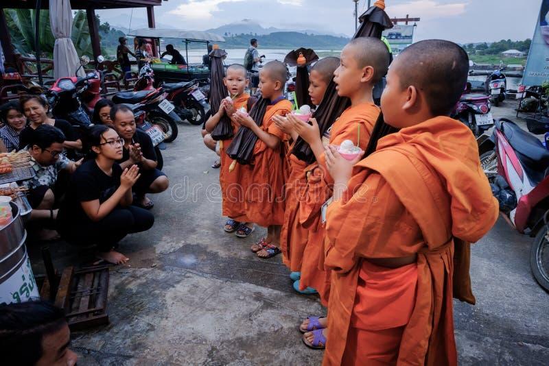 People worship Little monks. Kanchanaburi, Thailand - October 14, 2016:People worship Little monks on mon refugees village. Sangkhaburi, Kanchaburi,Thailand royalty free stock photography