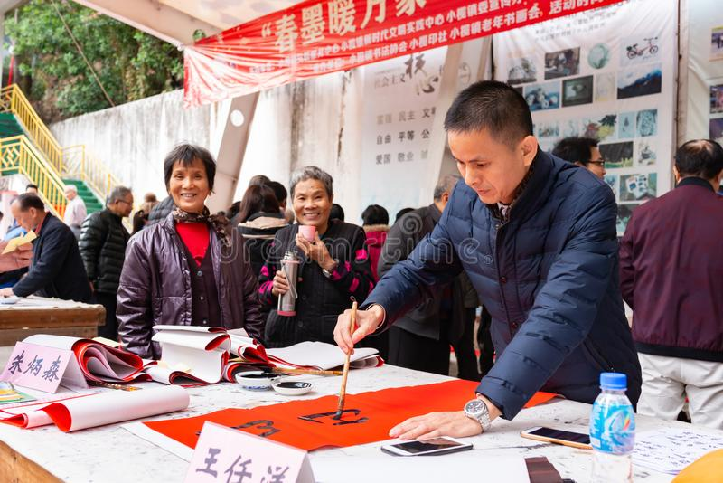 People writing Chinese new year scrolls royalty free stock photography