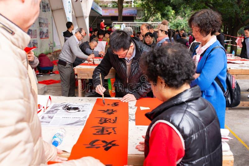 People writing Chinese new year scrolls stock image