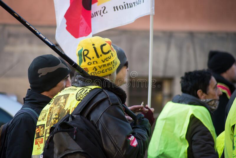 People with yellow vest protesting against the pension reforms from the government stock images