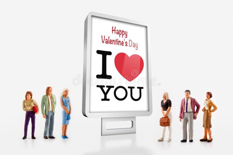 Peoples celebrate Valentine`s Day. Miniature people - peoples celebrate Valentine`s Day stock image