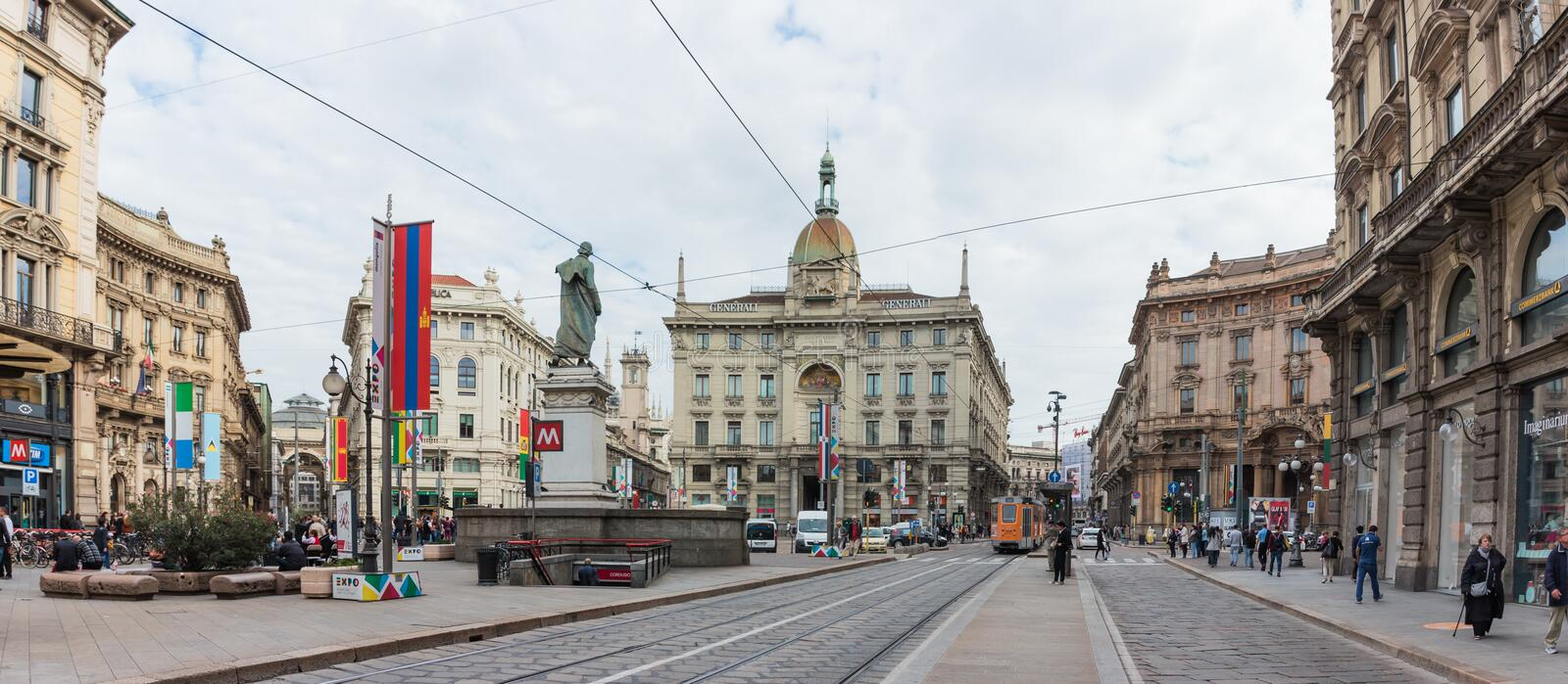 Peoples in decorated Dante Avenue and Piazza Cordusio in Milan. Milan, Italy - September 29, 2015 : The daily life of the city of Milan. Numerous passers-by and stock image