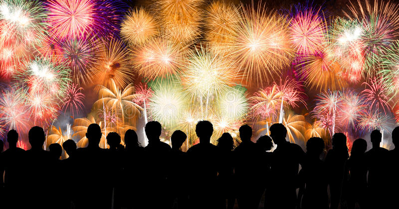 Peoples in silhouette enjoy watching amazing firework. Show in a festival or holiday stock images