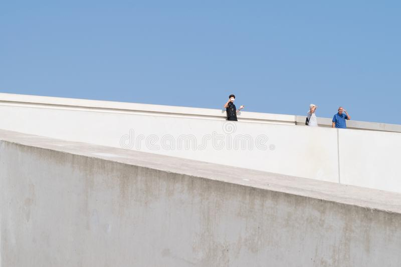 Peoples taking photos on top of the Moesgaard Museum in Aarhus. Shoot in Denmark on September 2016 stock photos