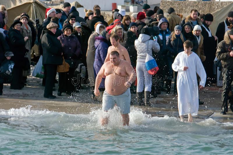 Peopls swimming in ice cold water Black Sea during Epiphany (Holy Baptism) in the Orthodox tradition royalty free stock image