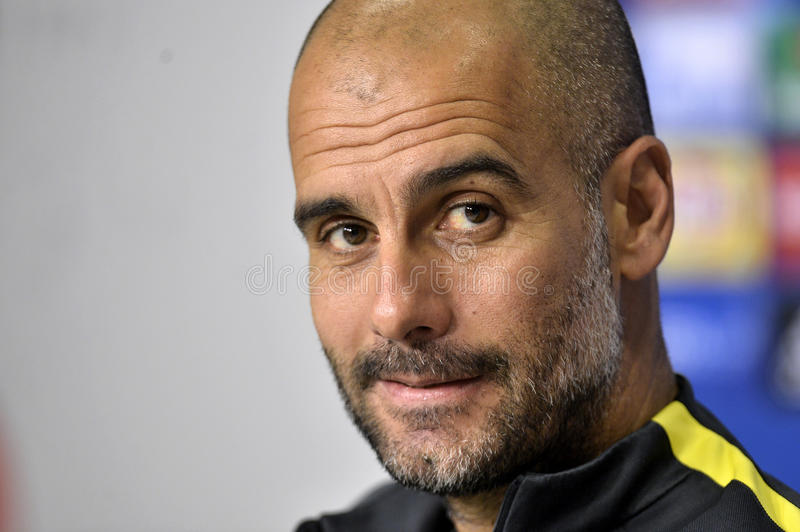 Pep Guardiola. Manchester City FC's coach Pep Guardiola attends a press conference before the Steaua Bucharest and Manchester City FC match at the National Arena stock image