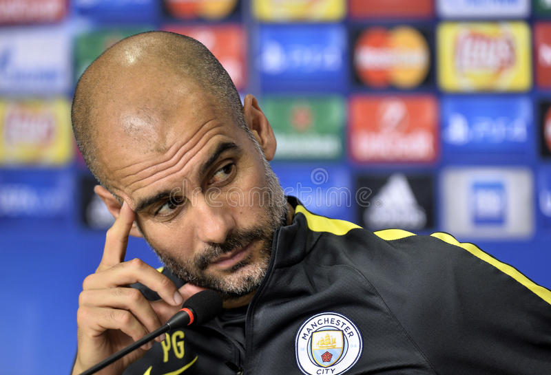 Pep Guardiola. Manchester City FC's coach Pep Guardiola attends a press conference before the Steaua Bucharest and Manchester City FC match at the National Arena royalty free stock photos