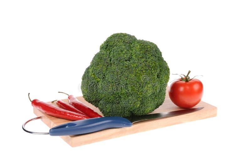Pepe e lama di tomatto del broccolo fotografia stock libera da diritti