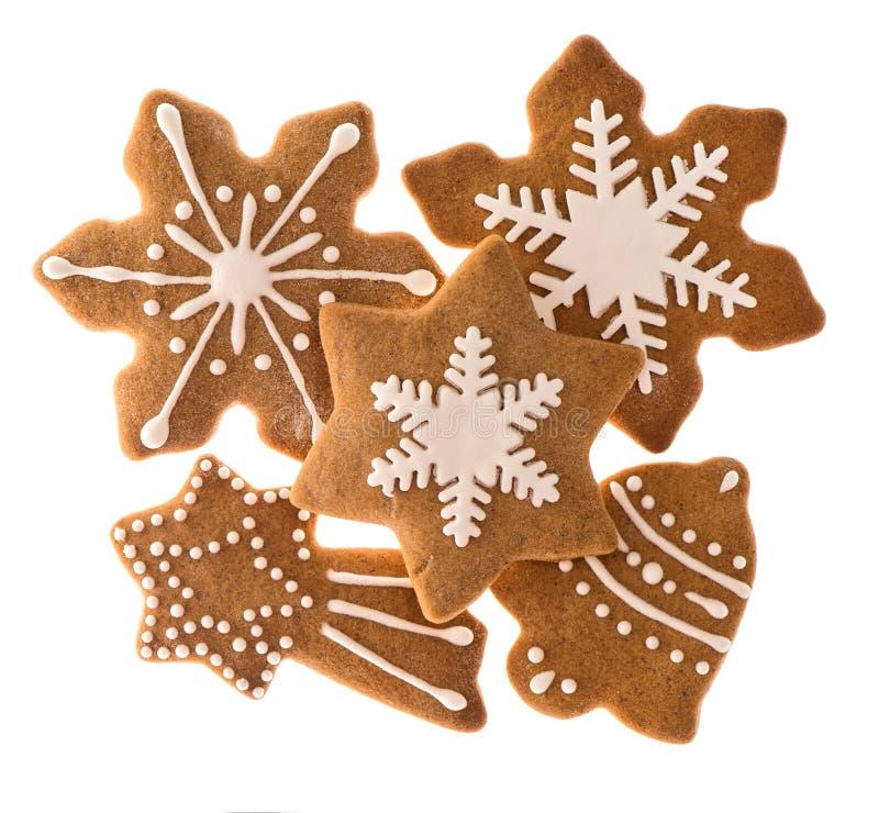 Peperkoekkoekjes op wit worden geïsoleerd dat Kerstmisvoedsel stock fotografie