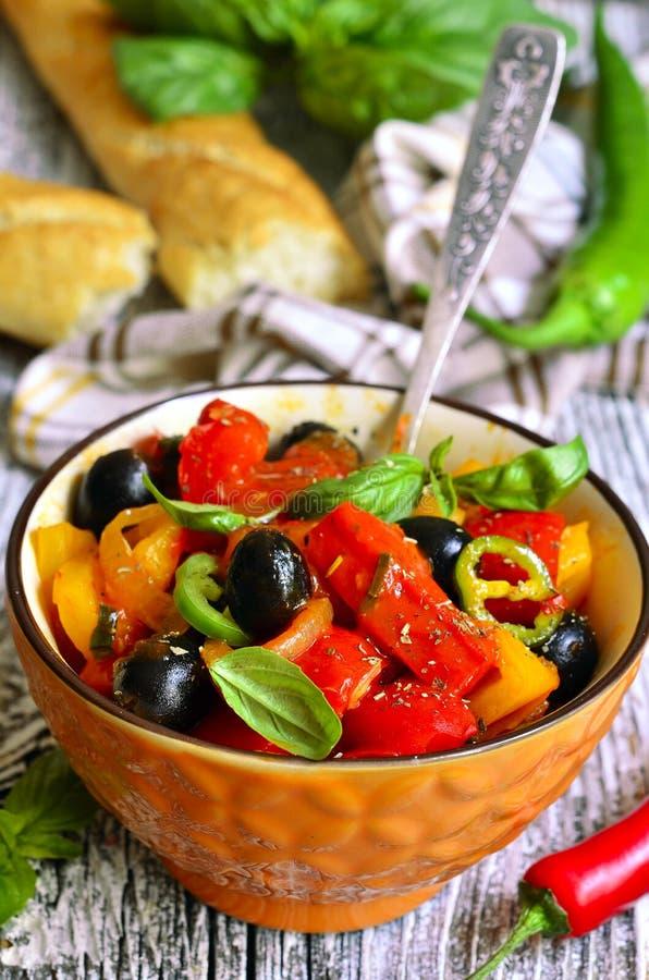 Peperonata - traditional dish of italian cuisine. Rustic style stock photos