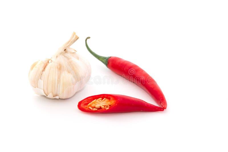 Peperoncini rossi ed aglio rossi fotografia stock