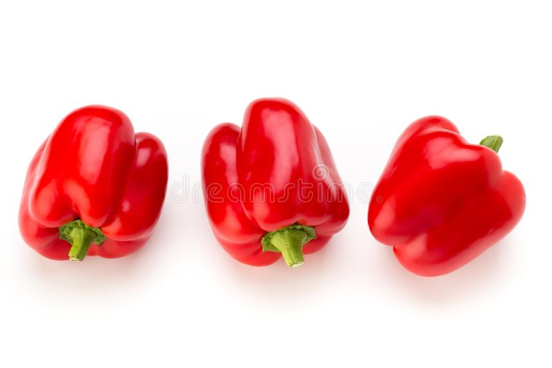 Peperone dolce rosso con la metà e foglie isolate su bianco fotografie stock