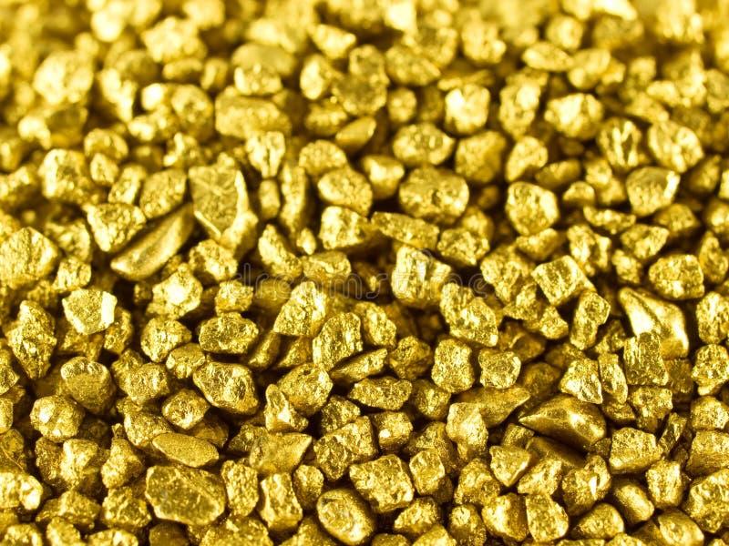 Pepitas de oro macras fotografía de archivo libre de regalías