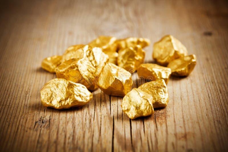 Pepitas de ouro imagens de stock
