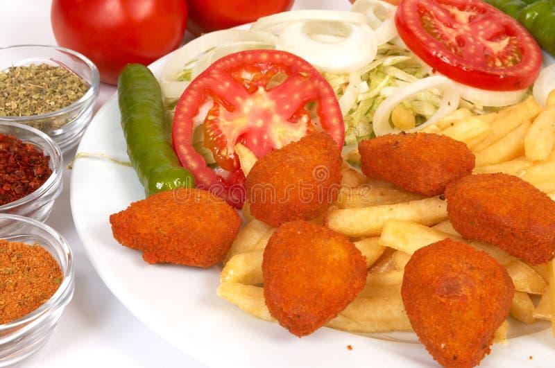 Download Pepitas de pollo foto de archivo. Imagen de fritadas, hambriento - 1294266