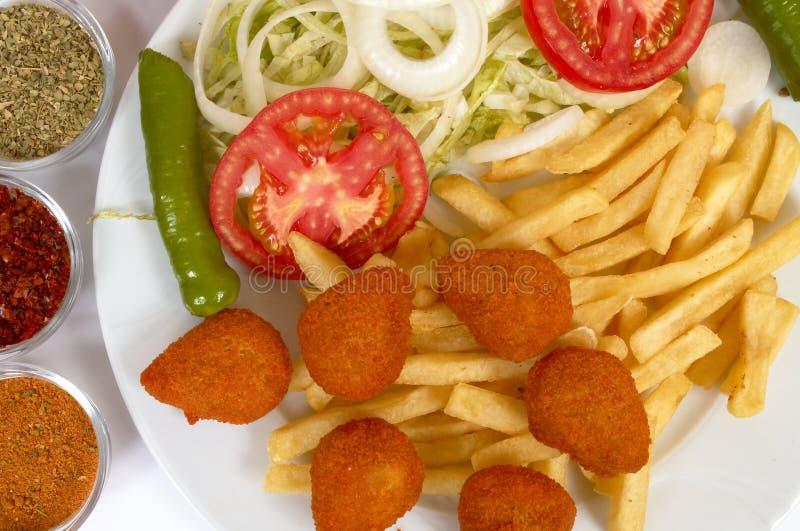 Download Pepitas de pollo foto de archivo. Imagen de francés, delicioso - 1294274