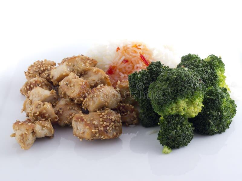 Pepite di pollo con broccolo fotografia stock