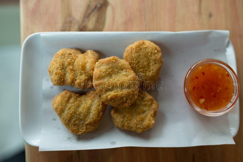 Pepite di pollo fritto fotografia stock libera da diritti