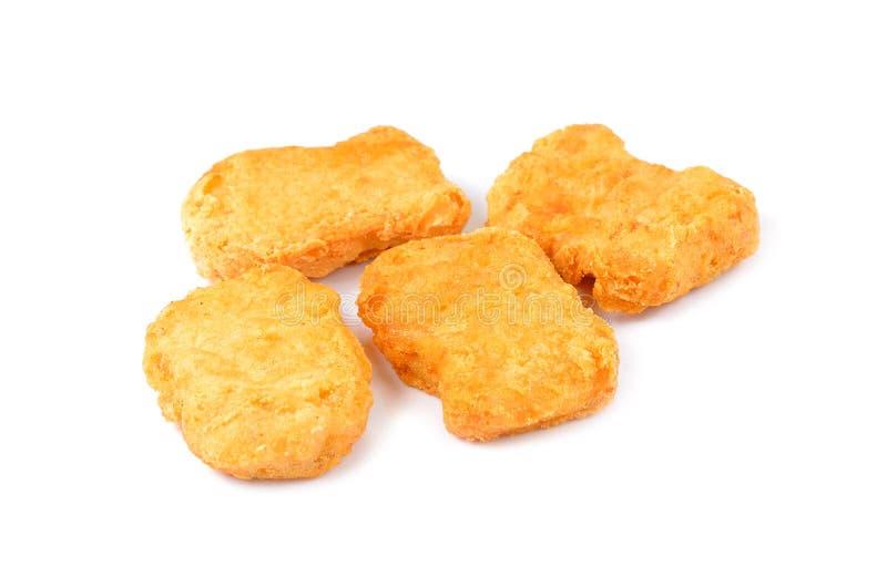 Pepite di pollo fritto isolate su priorità bassa bianca fotografia stock libera da diritti