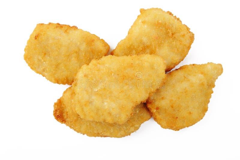Pepite di pollo fritto su bianco immagini stock