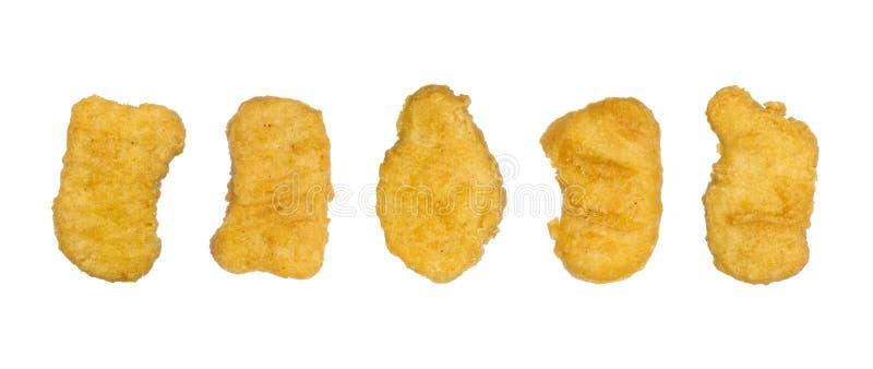 Pepite di pollo in una fila immagini stock