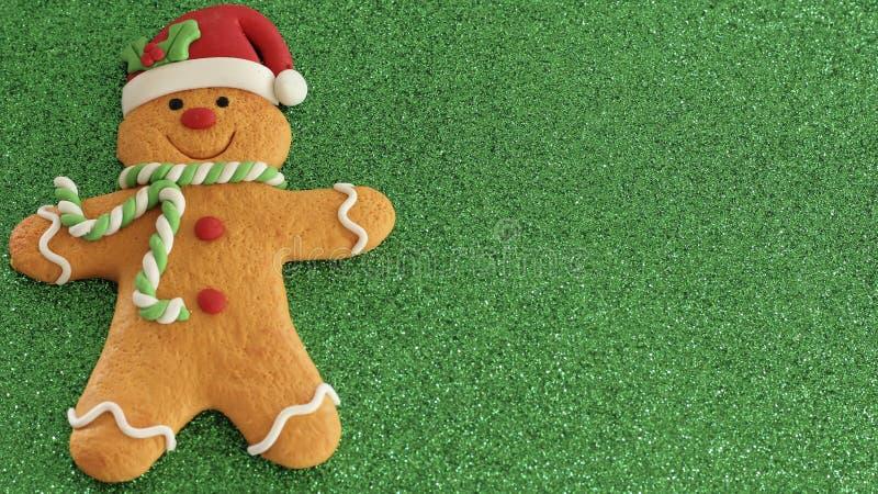 Pepparkakaman med den röda halsduken för gräsplan för hatt för jultomten vit och på en grön bakgrund med att skriva utrymme arkivbild