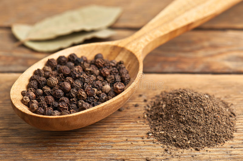 Pepper and bay leaves stock photos
