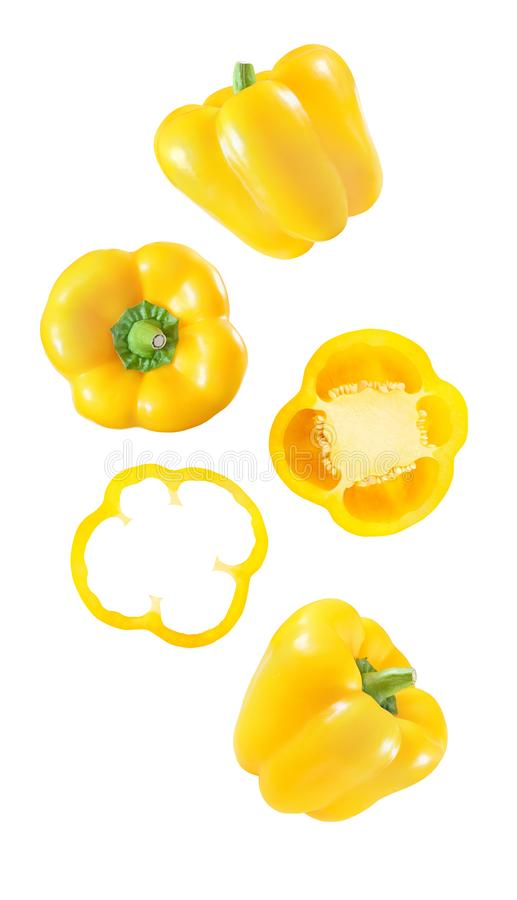 Pepper bell yellow the set of the falling, soaring, hanging, flying whole and cut pieces slices isolated on white background with stock photos