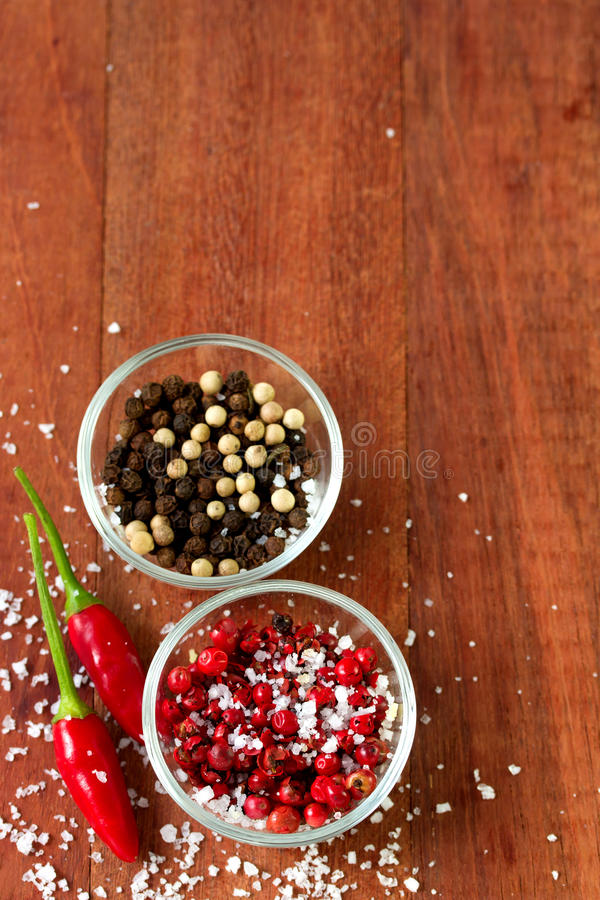 Pepper in bowls. On brown background royalty free stock photography