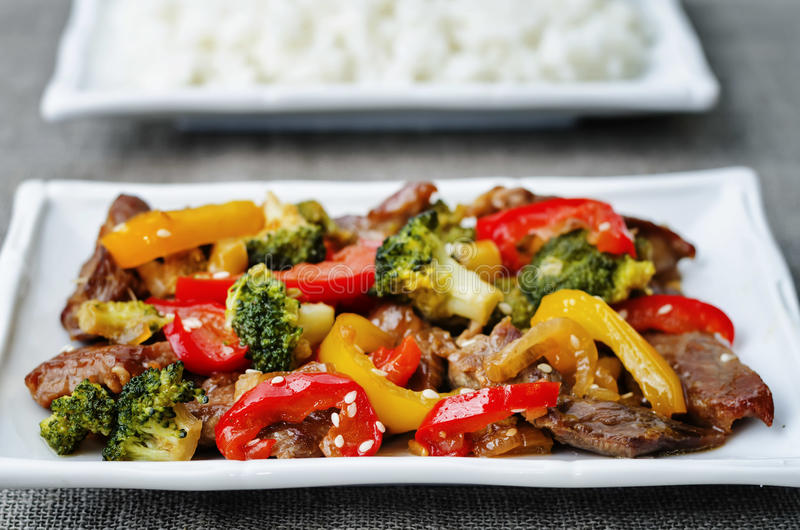 Pepper broccoli beef stir fry. On a dark background. the toning. selective focus royalty free stock images