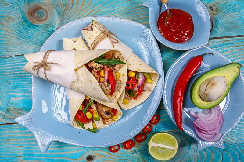 Pepper, corn black bean quinoa burritos Tortilla, sandwiches twisted rolls. top view.  stock photo