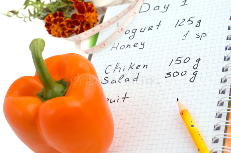 Pepper and diet-book. Diet-book, pepper and measure tape on white background royalty free stock image