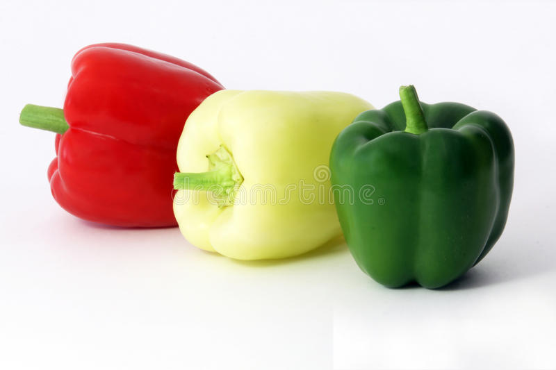 Pepper fresh green red and yellow fruits stock images