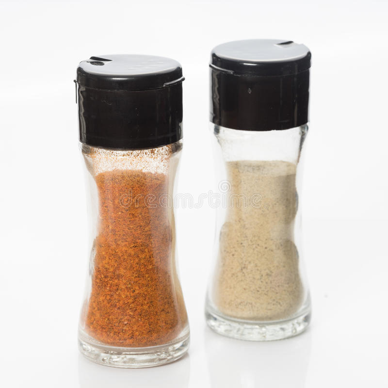 Pepper and ground chilli bottle. On White background stock photography
