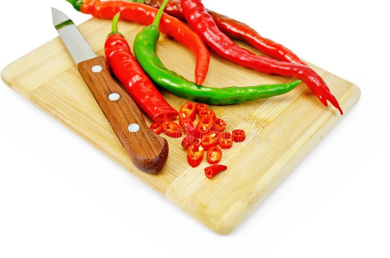 Pepper hot with knife stock image