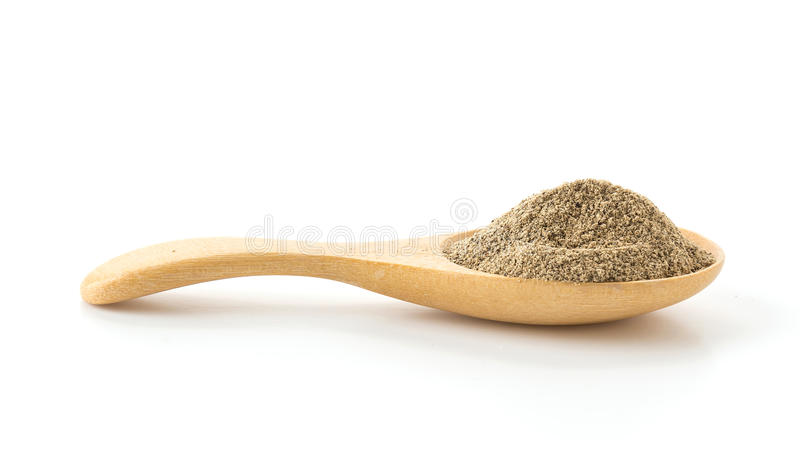 Pepper powder. On wood spoon royalty free stock photography