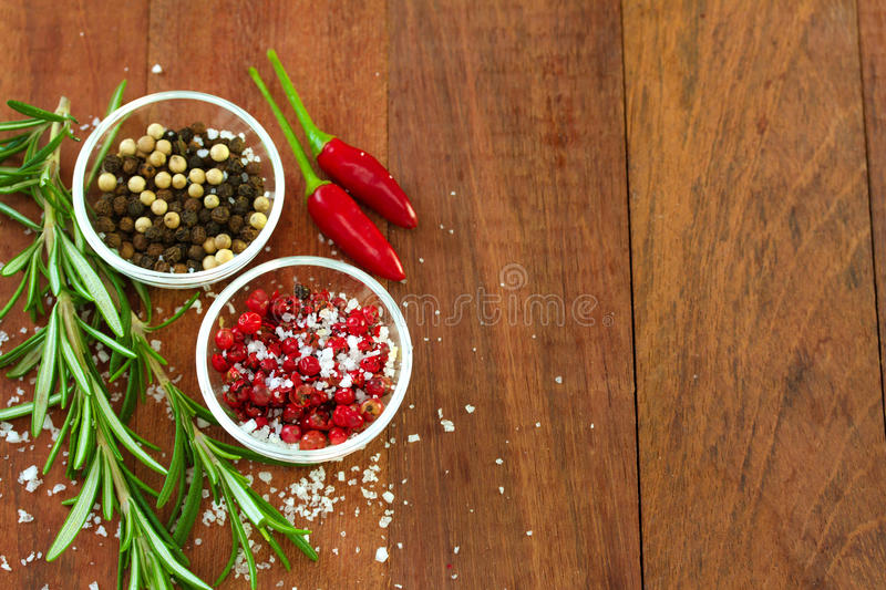 Pepper with salt. And rosemary royalty free stock photos