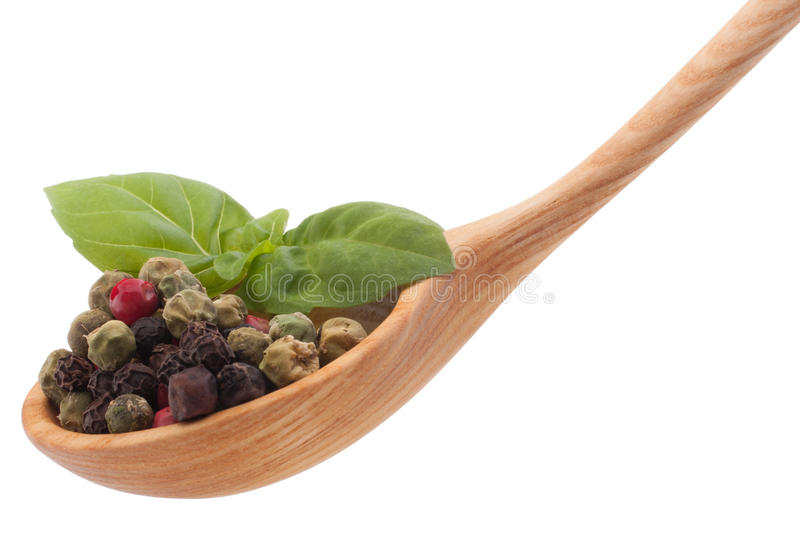 Pepper seasoning mix in wooden spoon isolated on white backgrou stock photos