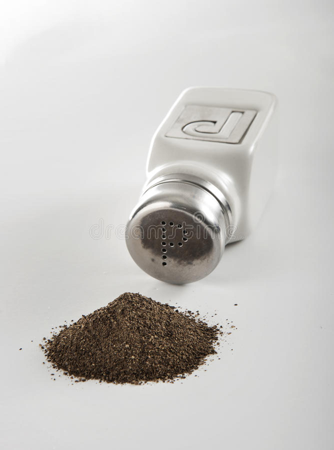 Pepper Shaker and Pile royalty free stock photos