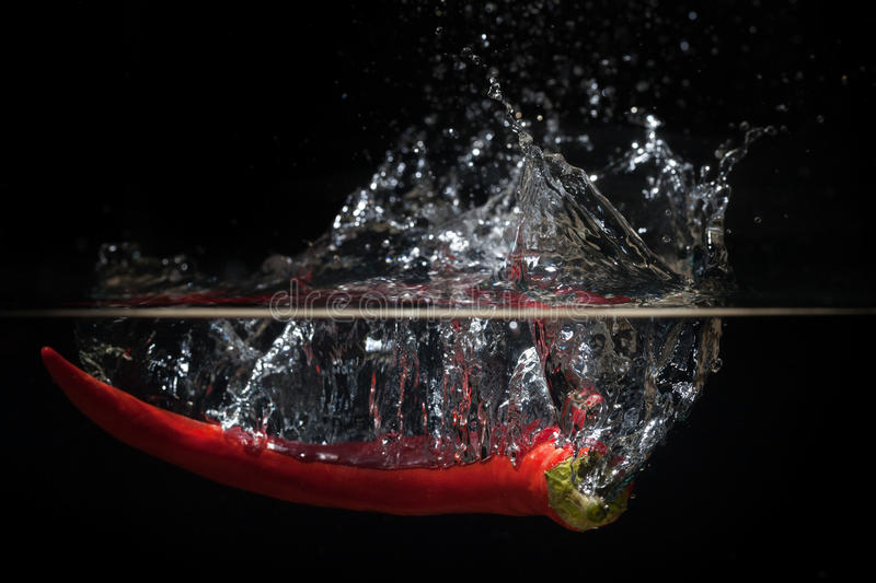 Pepper in the water. Pepper dropped into the water royalty free stock photos