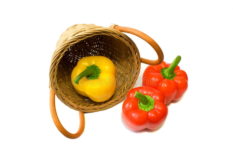 Pepper and wattled basket isolated on a white stock images