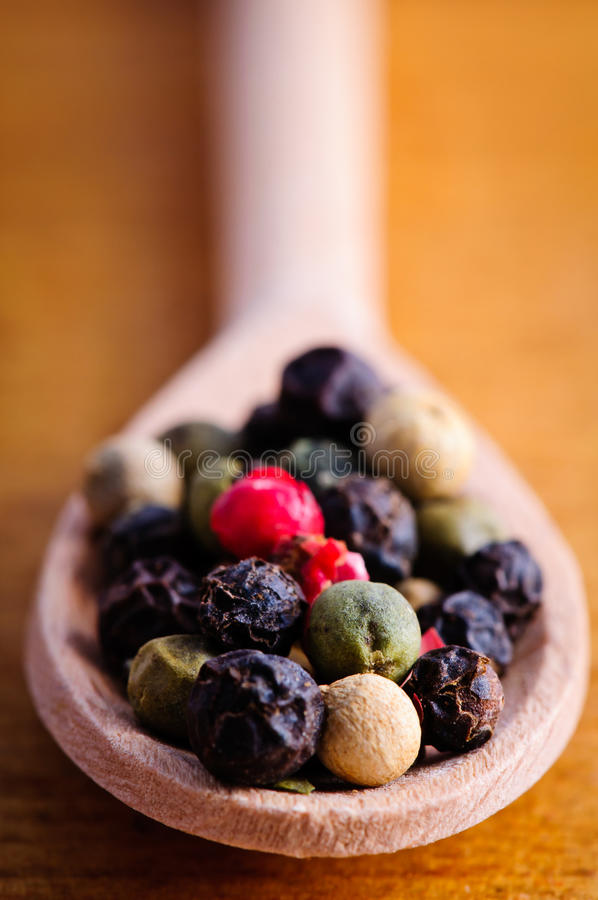 Download Pepper in wooden spoon stock image. Image of color, macro - 22900231