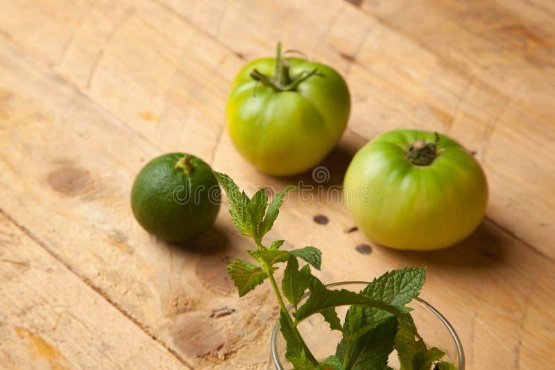 Mint, tomato and green orange. Green range royalty free stock photography