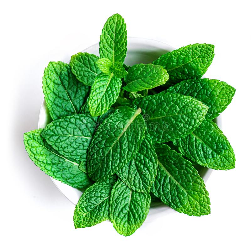 Peppermint leaf isolated on white background. Heap of Mint, Spearmint leaves, close up. Top view royalty free stock images