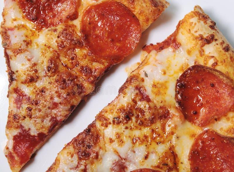 Pepperoni φέτες πιτσών στοκ φωτογραφίες με δικαίωμα ελεύθερης χρήσης