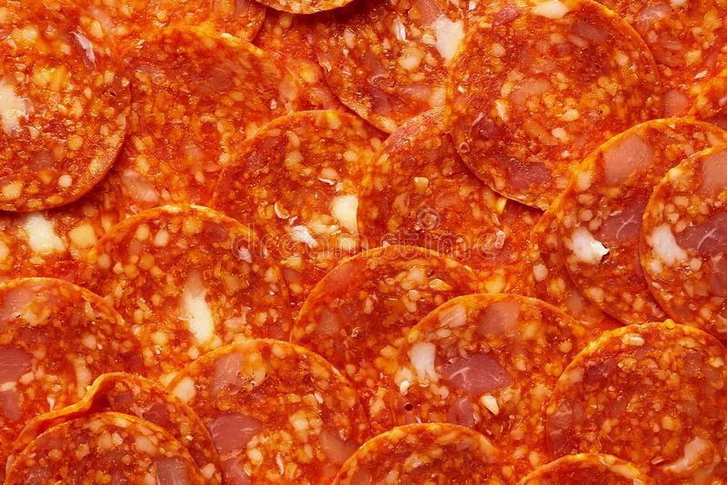 Pepperoni or Chorizo Slices Pattern. Ingredients for meat pizza. royalty free stock images
